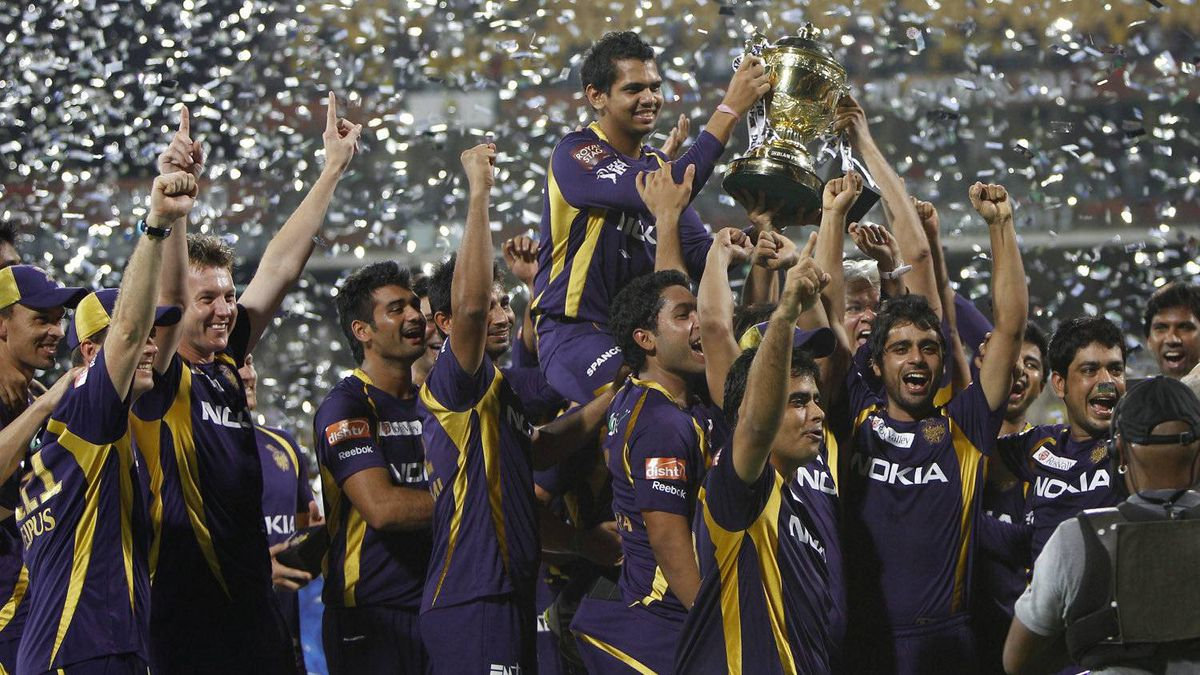 Players and support staff of Kolkata Knight Riders celebrate with the trophy after their win against Chennai Super Kings' in the Indian Premier League (IPL) final cricket match in Chennai, India, Sunday, May 27, 2012. Kolkata Knight Riders won the match by five wickets. (AP Photo/Aijaz Rahi)