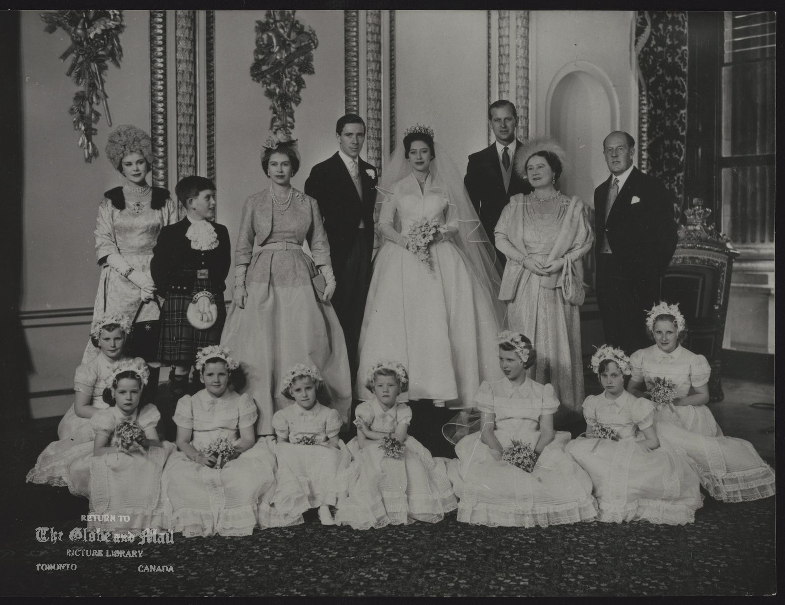 ROYAL FAMILY Great Britain Princess Margaret (Wedding) BRIDAL GROUP -- WEDDING GROUP IN THE THRONE ROOM OF BUCKINGHAM PALACE MAY 6, TAKEN BY PHOTOGRAPHER CECIL BEATON. STANDING LEFT TO RIGHT: COUNTESS OF ROSSE, PRINCE CHARLES, QUEEN ELIZABETH II; ANTONY ARMSTRONG-JONES; PRINCESS MARGARET; THE DUKE OF EDINBURGH, QUEEN ELIZABETH THE QUEEN MOTHER; AND MR. RONALD ARMSTRONG-JONES. EIGHT BRIDESMAIDS SEATED LEFT TO RIGHT; LADY ROSE NEVILL; SARAH LOWTHER; ANNABEL RHODES; CATHERINE VESEY; LADY VIRGINIA FITZROY; PRINCESS ANNE; ANGELA NEVILL; AND MARILYN WILLS.