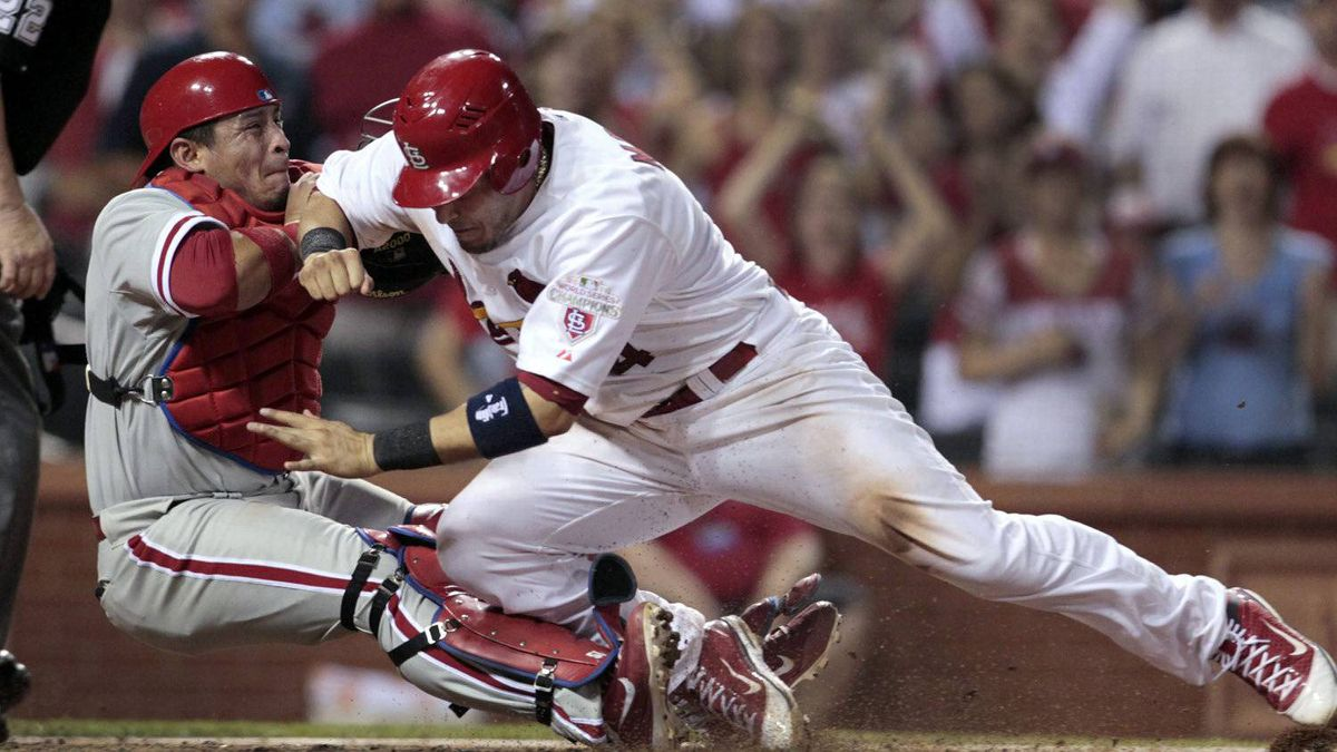 St. Louis Cardinals' Yadier Molina, right, is out as he collides with Philadelphia Phillies catcher Carlos Ruiz while trying to score during the eighth inning of a baseball game Friday, May 25, 2012, in St. Louis. Philadelphia won 5-3. (AP Photo/Jeff Roberson)