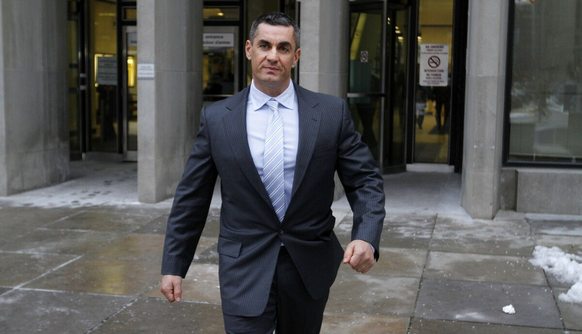 Christopher Quigley, witness in the trial against five former drug squad officers charged on alleged falsification of notes, assaults on drug dealers and illegal searches walks out of the University Ave. Courthouse, Toronto Jan. 16, 2012.