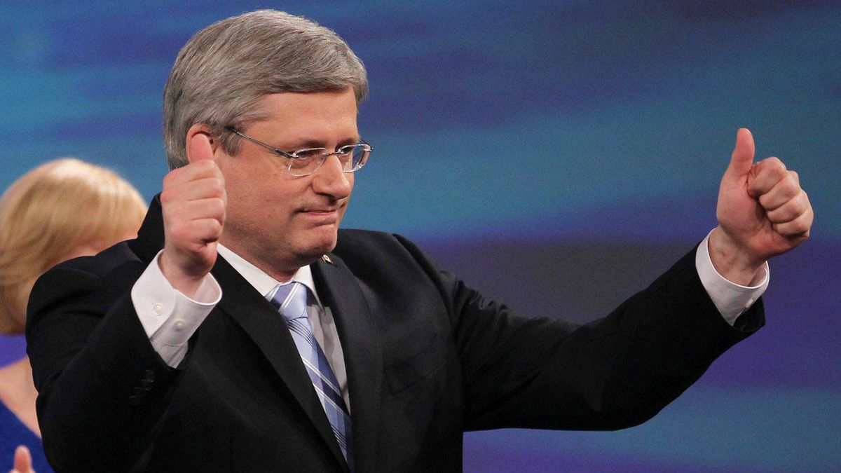 Prime Minister Stephen Harper gives the thumbs up as he arrives on stage following his majority win in Calgary, Alta, Monday, May 2, 2011.