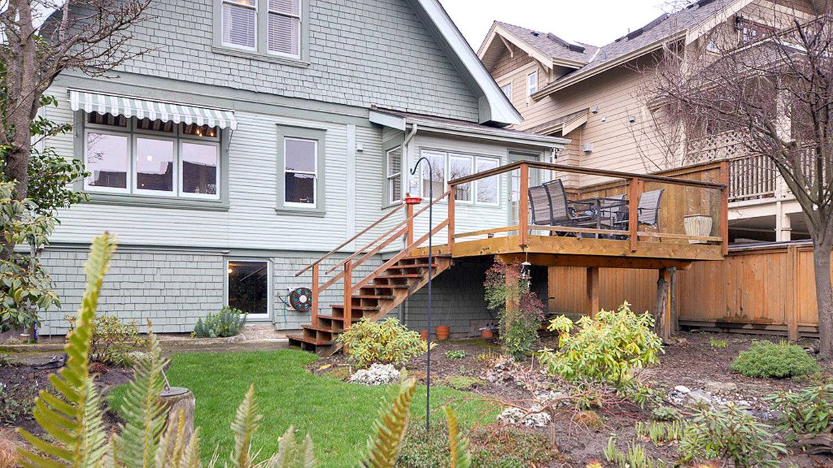 A large south-facing deck overlooks the landscaped yard.