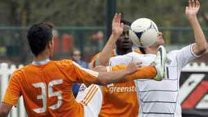Vancouver Whitecaps midfielder Michael Manchoff takes one to the face from Houston forward Emerson Sato (35) during a soccer match at the Walt Disney World Pro Soccer Classic, Sunday, Feb. 26, 2012, in Lake Buena Vista, Fla. (AP Photo/Reinhold Matay)