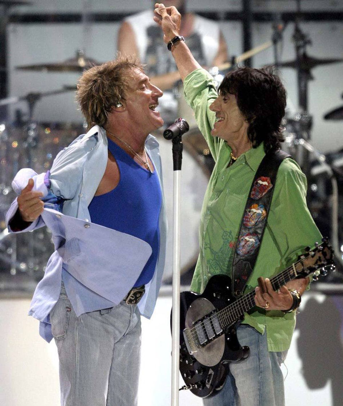 "Rod Stewart (left) and Rolling Stones' guitarist Ron Wood performed on stage together in 2004 for the first since they were in ""The Faces."" The Small Faces were founded by bassist Ronnie Lane, who died in 1987. When the band's lead singer left, Lane formed a new band, The Faces, that featured Stewart on lead vocals and Wood on guitar."