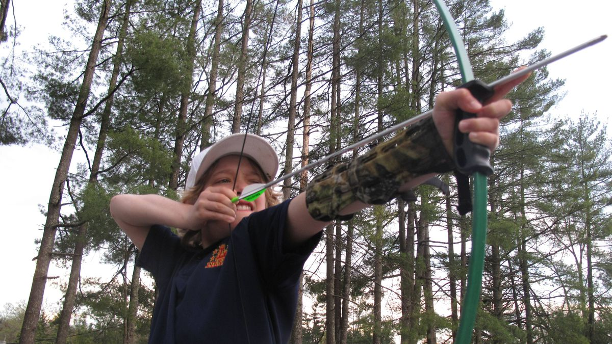 Learn the fundamentals of shooting a bow and arrow with the Hunger Games Fan Tour in Brevard, N.C.