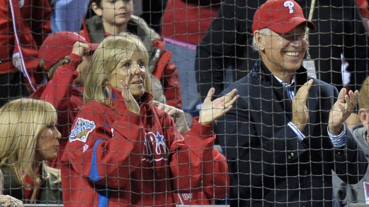 U.S. Vice President Joe Biden (R) and his wife Jill Biden watch the Philadelphia Phillies host the St. Louis Cardinals during Game Five of the National League Divisional Series at Citizens Bank Park on October 7, 2011 in Philadelphia, Pennsylvania. (Photo by Drew Hallowell/Getty Images)