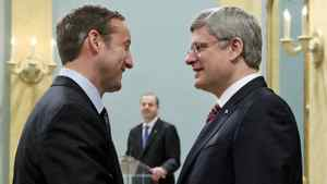 Peter MacKay shakes hands with Prime Minister Stephen Harper after being sworn in again as Minister of Defence at Rideau Hall on May 18, 2011.