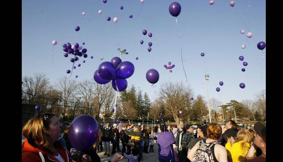 Hundreds of purple balloons containing information about then-missing Victoria Stafford were released into the sky in Woodstock, Ontario, Thursday, April 16, 2009.