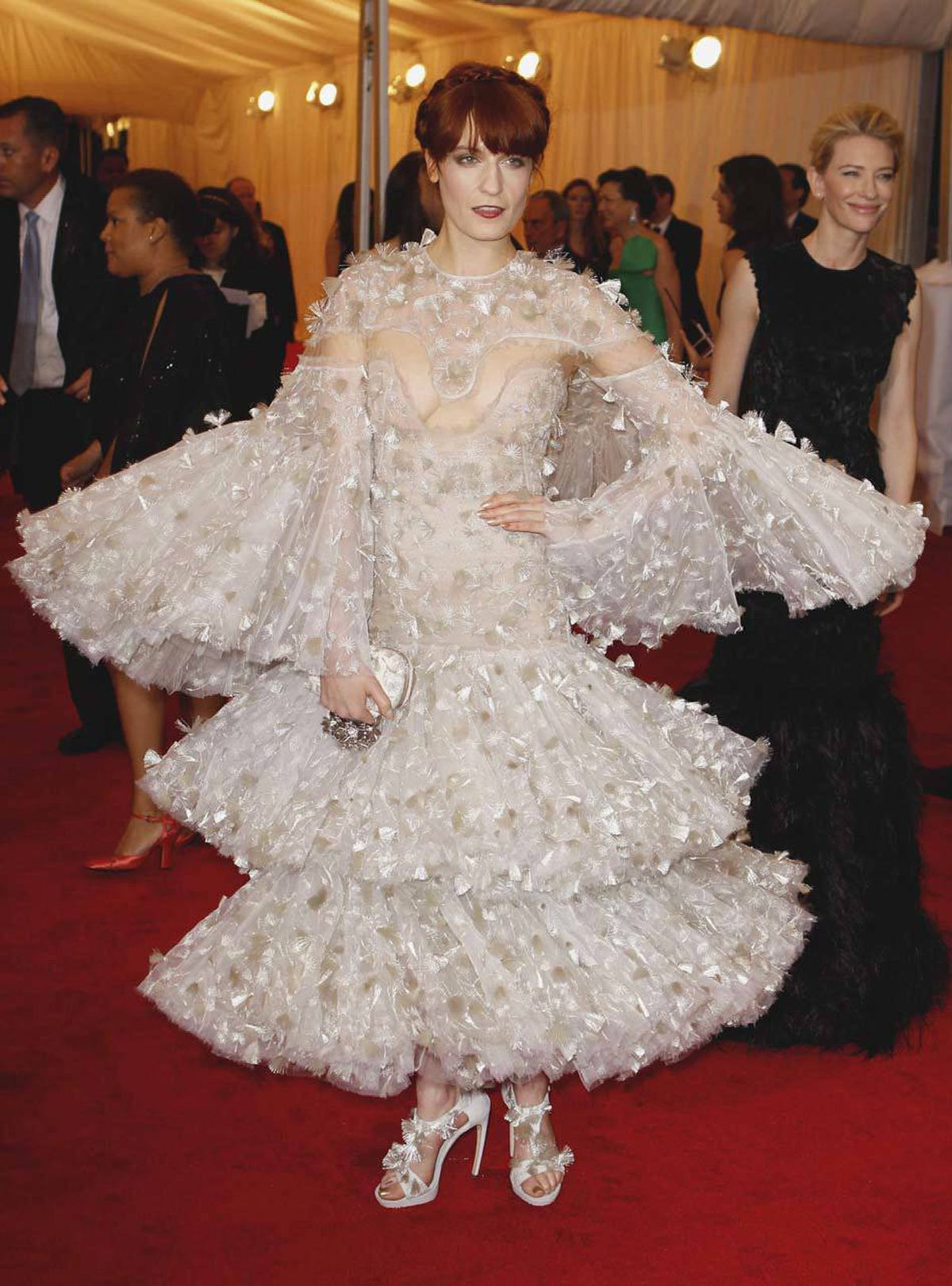 Singer Florence Welch attended at the Metropolitan Museum of Art Costume Institute Benefit dressed as a Christmas candle.
