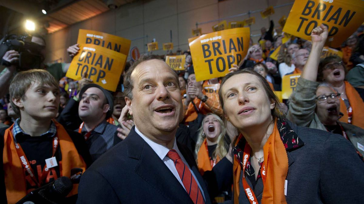 NDP leadership candidate Brian Topp, centre, stands with supporters at the convention in Toronto March 24, 2011.