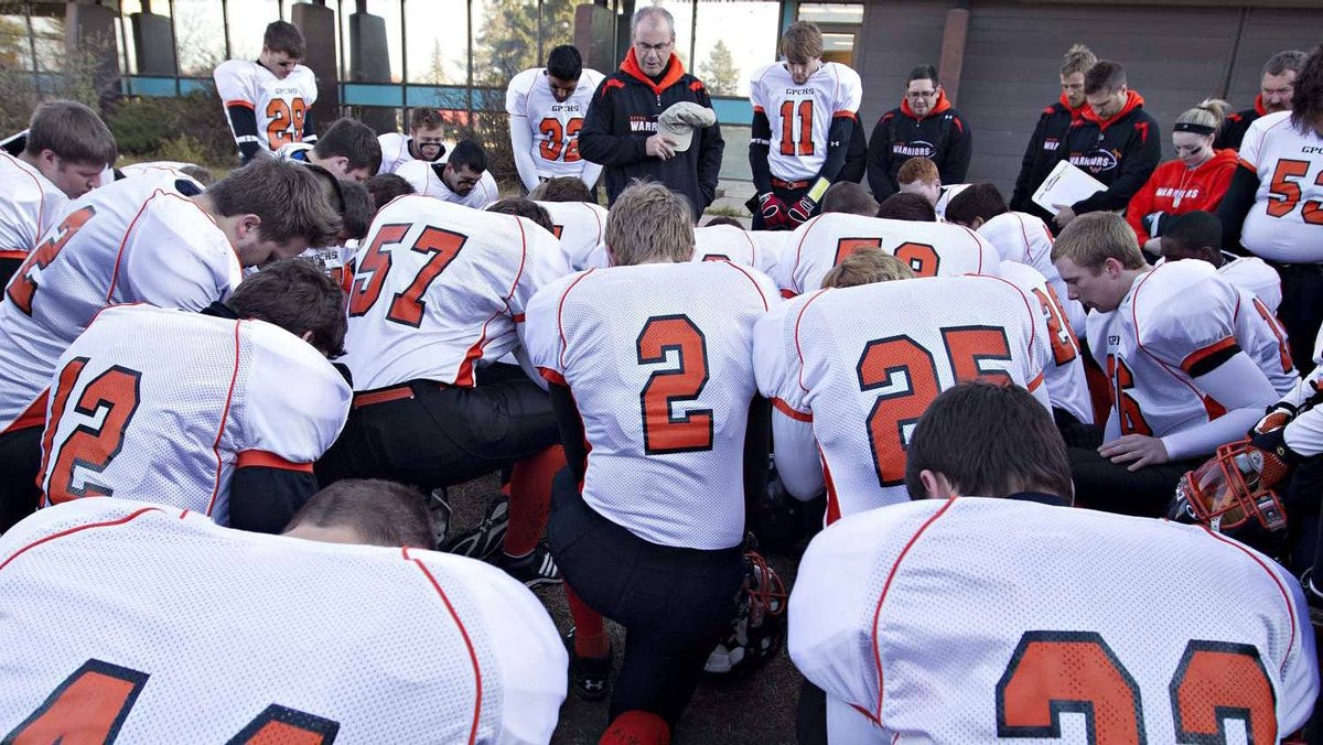 Grande Prairie Warriors coach Rick Gilson leads a prayer before a game against the Sexsmith Sabres on Oct. 29, 2011.