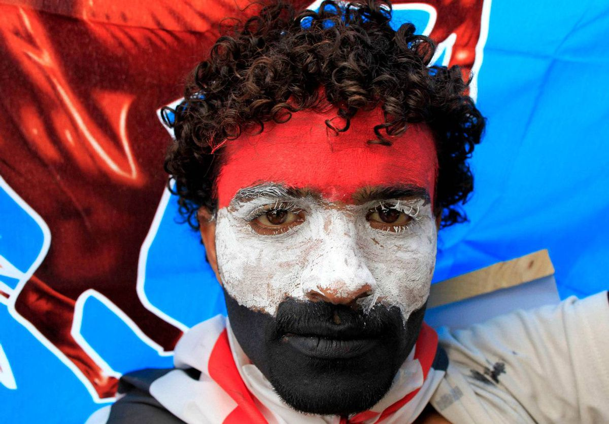 A Yemeni paints his face in the colours of the national flag during a rally in support of President Ali Abdullah Saleh in Sanaa May 6, 2011.