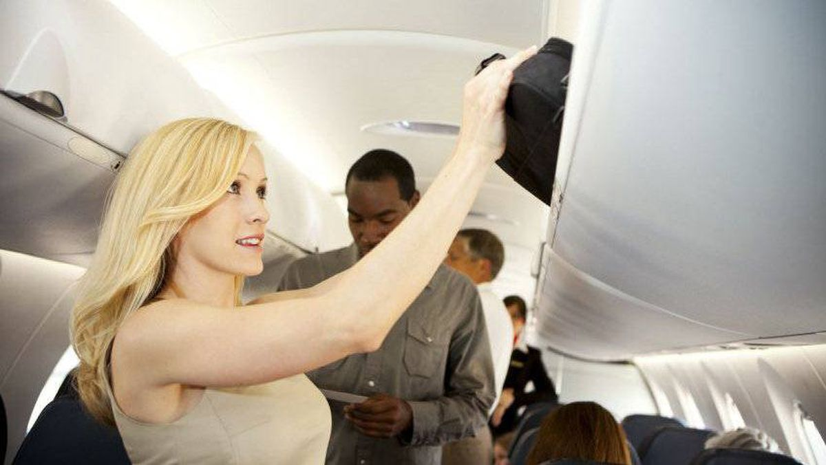 Stop cramming over-sized luggage into the overhead bins.
