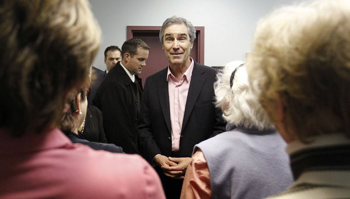 Liberal Leader Michael Ignatieff speaks with volunteers at a Quebec City community centre on April 5, 2011.