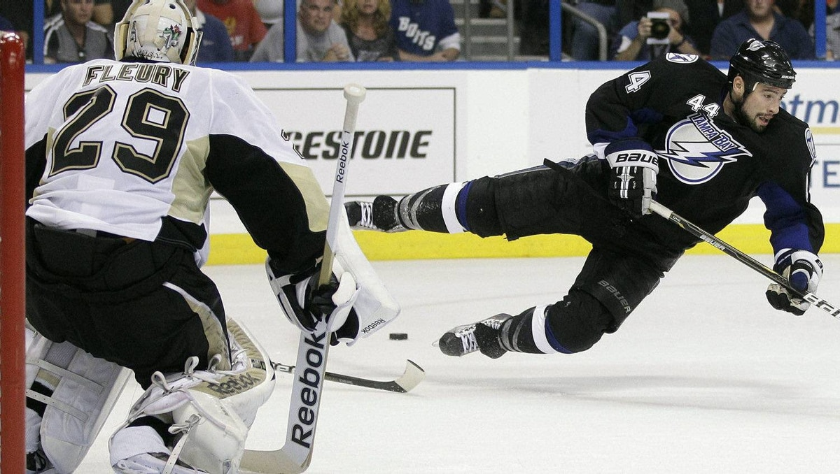 Tampa Bay Lightning center Nate Thompson (44) flies through the air after over skating the puck as he broke towards Pittsburgh Penguins goalie Marc-Andre Fleury (29) during the second period. The Penguins won 3-2. (AP Photo/Chris O'Meara)