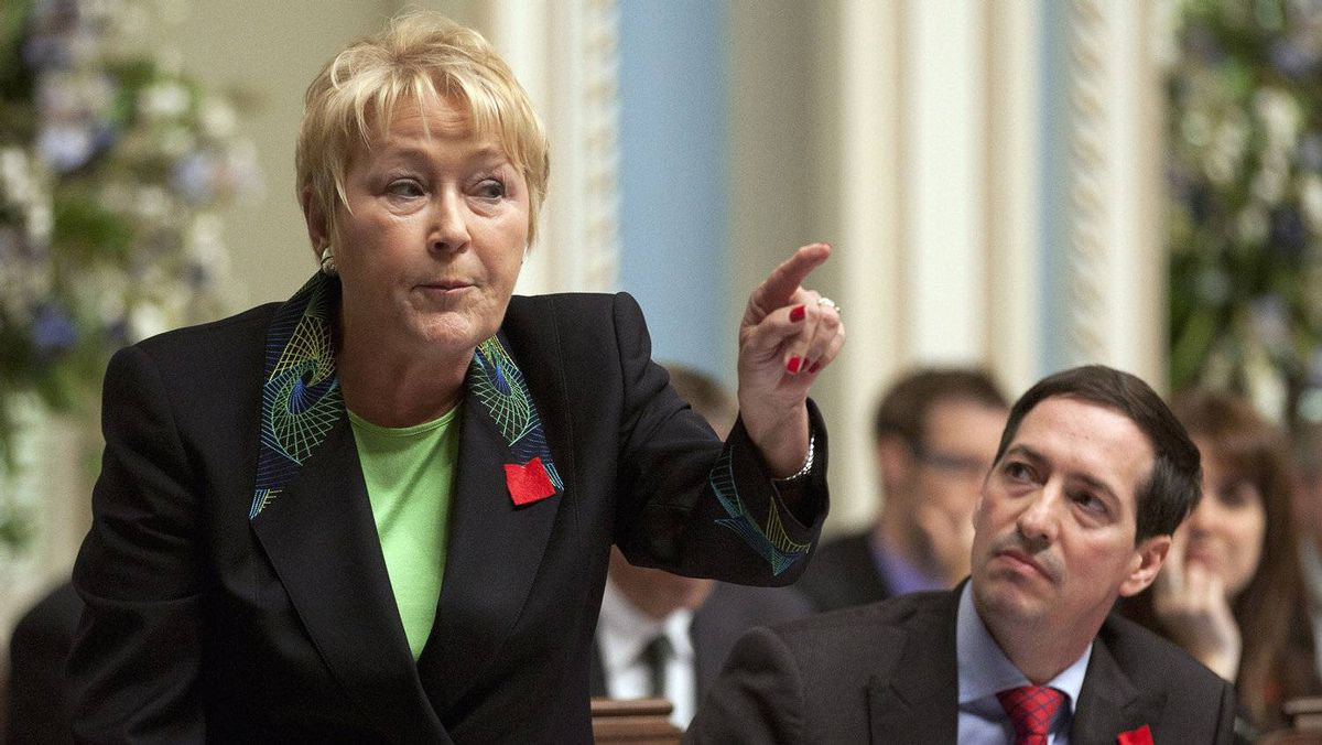 Quebec Opposition Leader Pauline Marois questions the government Thursday, May 3, 2012 at the legislature in Quebec City. Marois tabled a motion of non-confidence against the government. Opposition legislature leader Stephane Bedard, right, looks on.