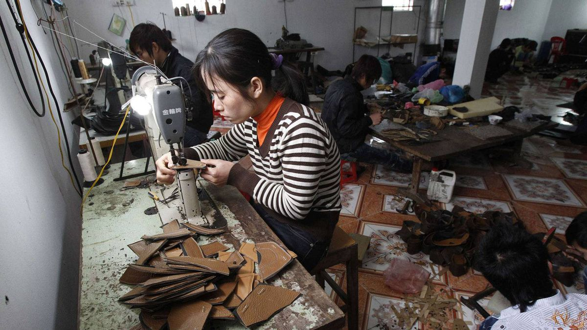 Labourers make shoes in Gie Ha, 40 km south of Hanoi. Rising inflation in Vietnam has sparked industrial unrest and more than 800 strikes in the first 11 months of 2011.