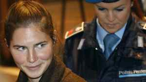 Defendant Amanda Knox, a 22-year-old American accused of killing her housemate, is accompanied by a penitentiary officer prior to a hearing at the court in Perugia, Italy. Luca Bruno/Associated Press