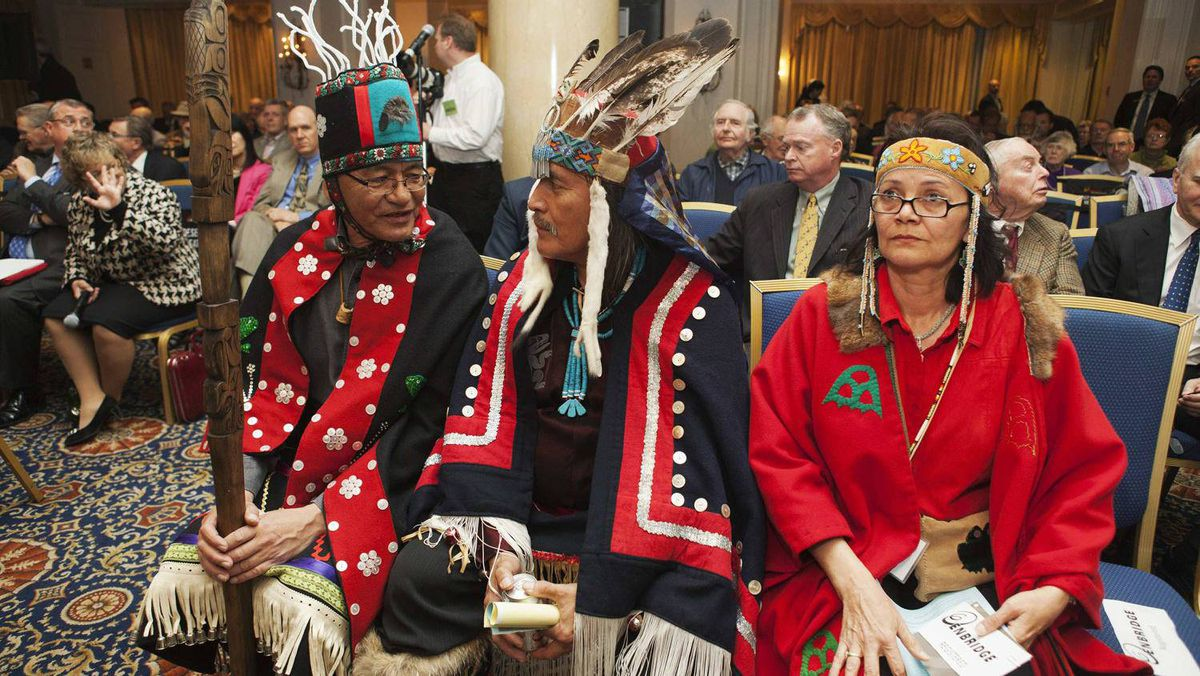 Chief Na'Moks of the Wet'suwet'en Nation, from left, Chief Martin Louie of Nadleh Whut'en, and Chief Jackie Thomas of the Saik'az nation sit in the front row. All were firm in their absolute opposition to the project, and warned years of legal action lie ahead if Enbridge presses ahead.