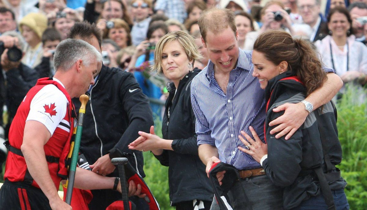 The Duke and Duchess of Cambridge hug after taking part in a dragon boat race in Dalvay Lake, P.E.I. Monday, July 4, 2011.