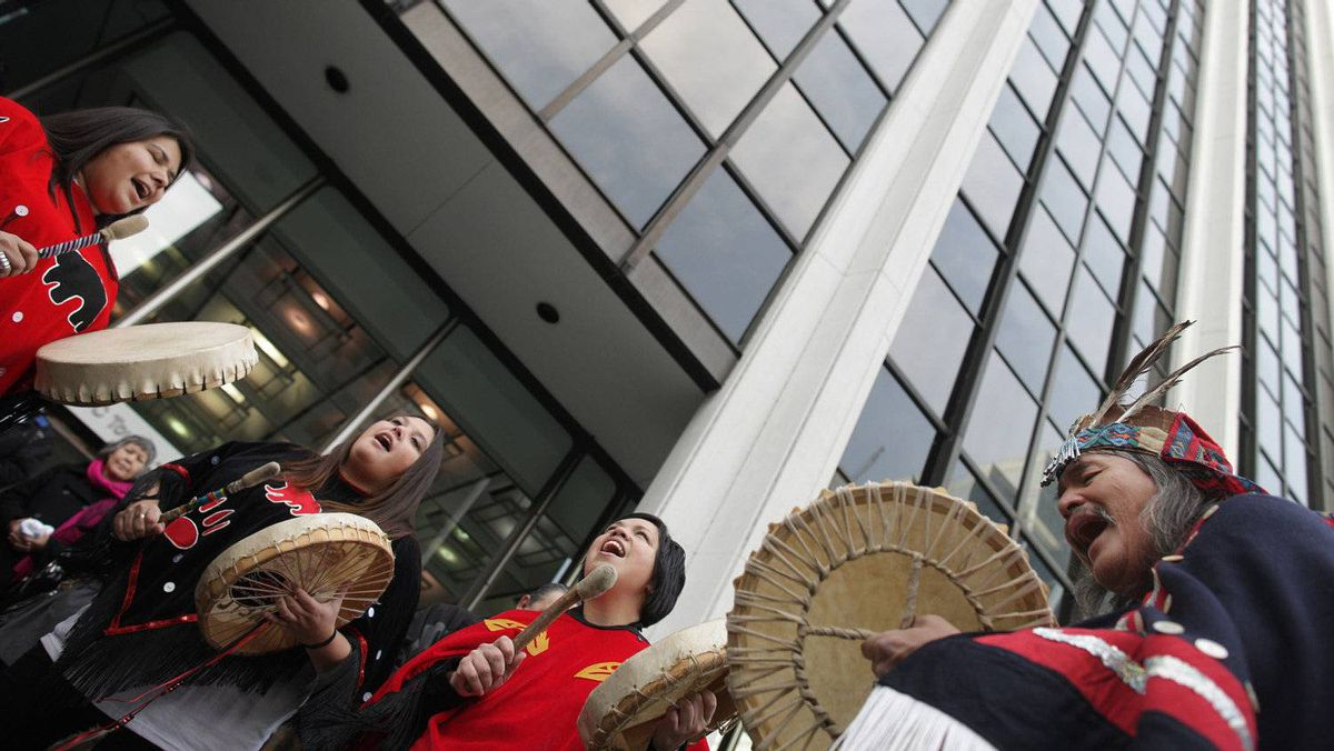 Native protestors demonstrate against the proposed Northern Gateway pipeline at Enbridge headquarters in Vancouver.
