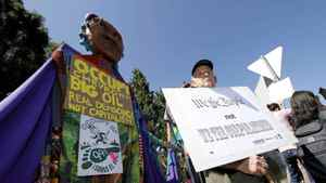 Protesters march during a protest outside the annual meeting at Chevron Corp. headquarters in San Ramon, Calif., on Thursday.