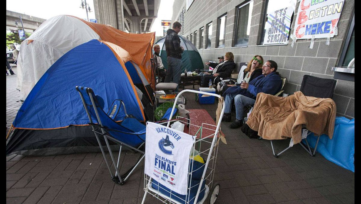 Vancouver Canucks fans camp outside Rogers Arena waiting to buy tickets for Game 7 of the NHL Stanley Cup Final hockey playoff.