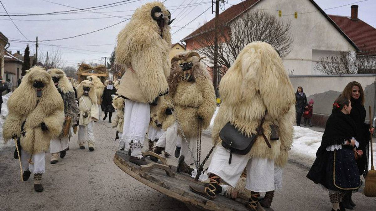 Masked 'Busho men' march through the town of Mohacs in southern Hungary during the annual Busho Carnival, Tuesday, Feb. 21, 2012.