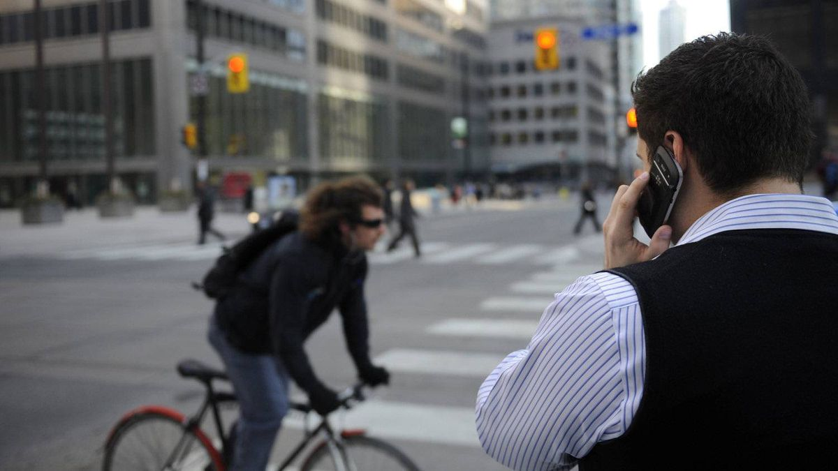 FILE PHOTO. A man on his Blackberry smartphone at the corner of Bay St. and King St. West on February 28 2012. (Fred Lum/The Globe and Mail)