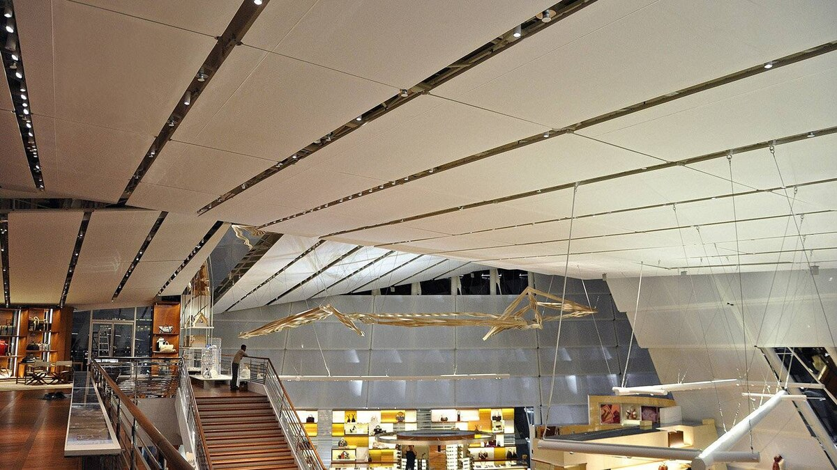 overing 25,000 square feet in total, each custom shade was manufactured in Toronto and then shipped to Singapore for just-in-time installation. The project won the Store of the Year award in the 2012 Association of Retail Environments design awards.