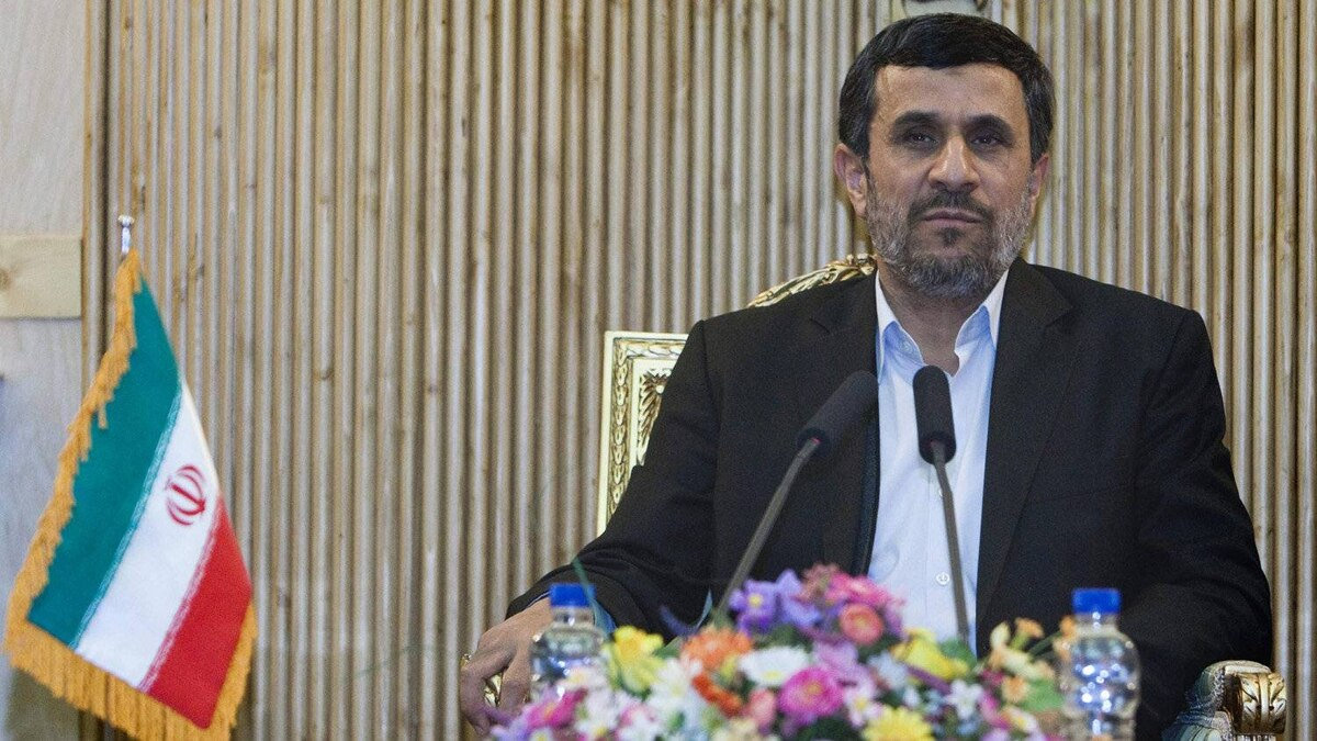 Iran's President Mahmoud Ahmadinejad speaks with journalists at Tehran's Mehrabad airport after his visit to Latin America, Jan.14, 2012.