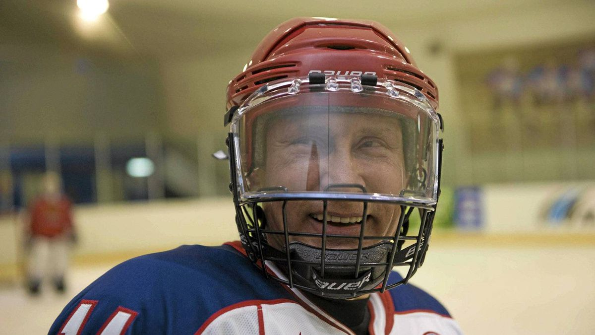 Vladimir Putin in a rare moment of levity on the ice.