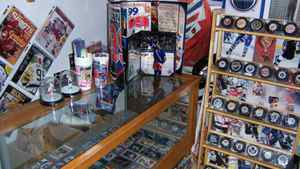 Ken LeBlanc's showcase and displays of sports cards, pucks and magazine covers. The thousands of cards he owns include rookie and autographed ones. He also has about 1,600 autographed pucks.