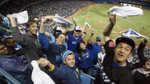 Toronto Blue Jays fans wave their rally towels.