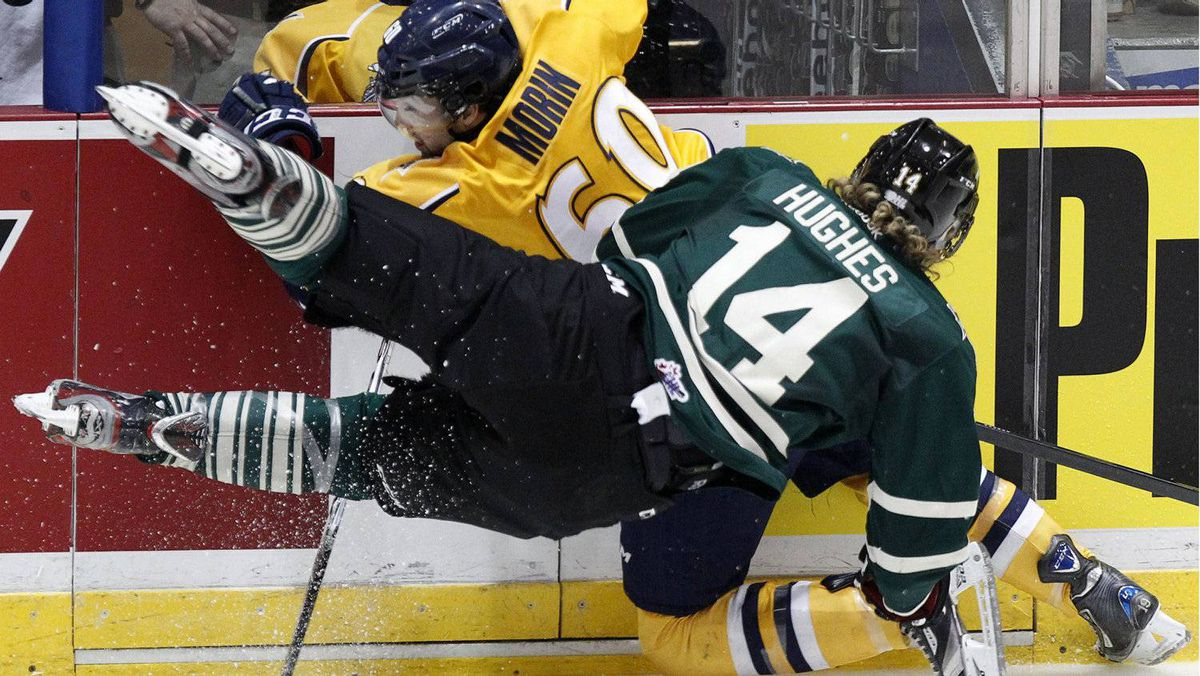 London Knights Tommy Hughes (14) collides with Shawinigan Cataractes Pierre-Olivier Morin (60) during the second period of their Memorial Cup final ice hockey game in Shawinigan, Quebec, May 27, 2012. REUTERS/Mathieu Belanger