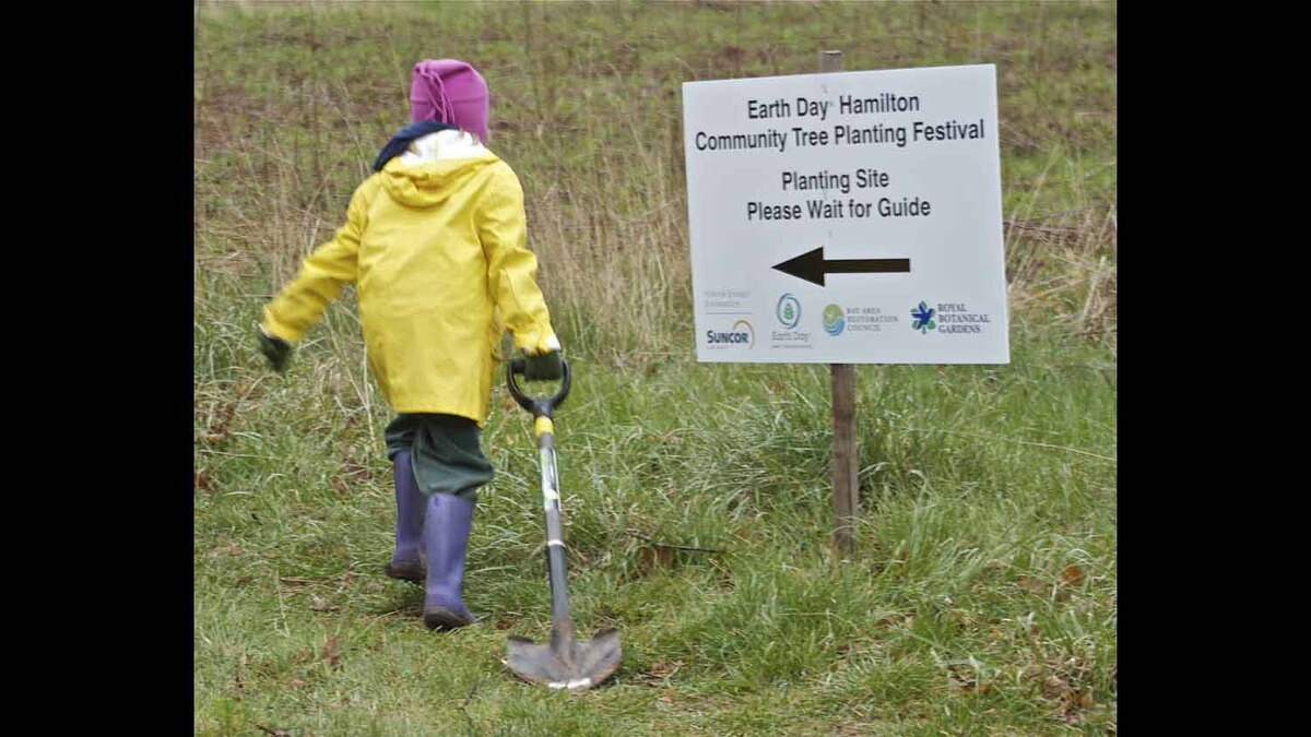 Taken on April 21st 2012 during Hamilton Earth Day Festival. This young lady had brought her own shovel and was one of the first up the hill ready to start tree planting!