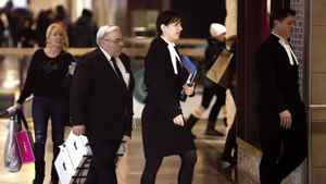 Accompanied by his lawyers, Winston Blackmore, third from right, makes his way into the Federal Tax Court in Vancouver on Monday, Jan. 23, 2012.