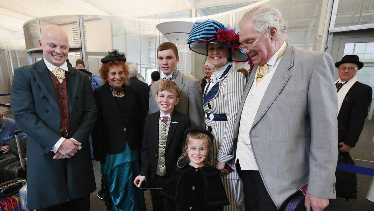 Three generations of the Free family from London and Manchester -- Graham, Marilyn, David, Ethan, 10, Rosie, 5, Jaki and Stan (L-R) wear period costumes while queuing to board the Titanic Memorial Cruise in Southampton, England April 8, 2012.