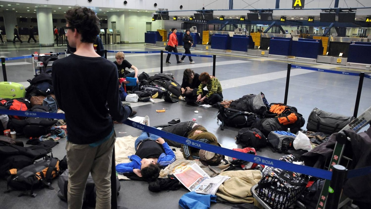European passengers sleep on the floor of Beijing Capital International airport after flights from China to Europe were cancelled on April 19, 2010