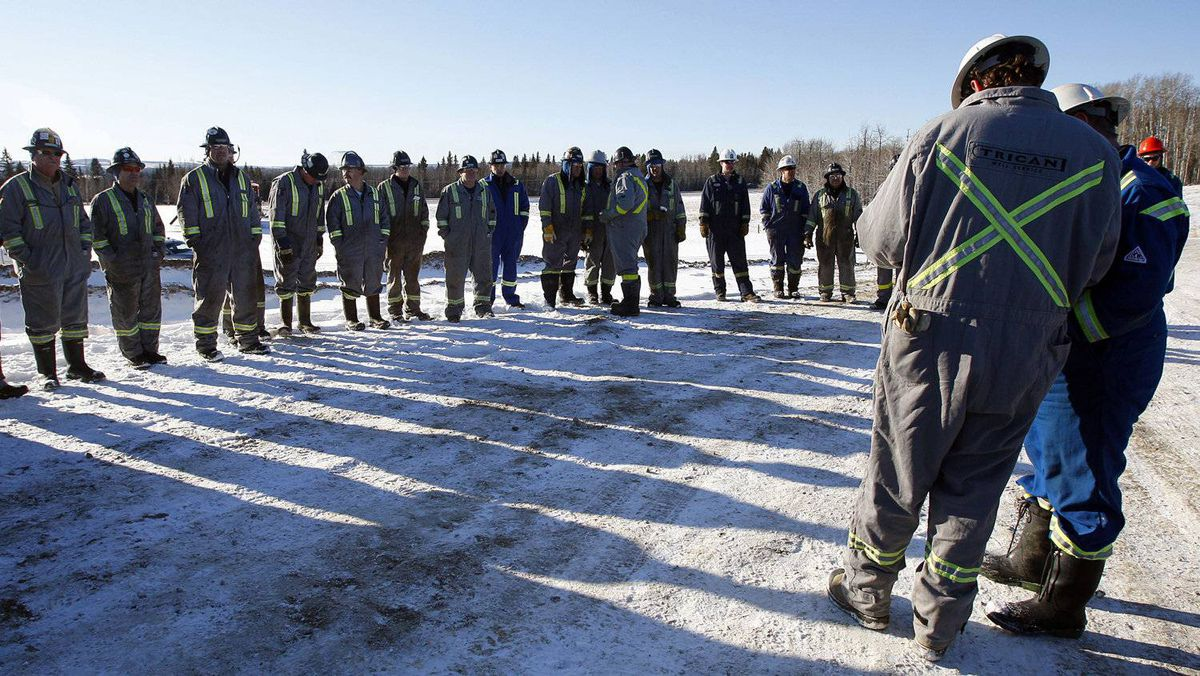 Workers assemble for a morning safety meeting prior to the start of a hydraulic fracturing operation near Bowden, Alta., Tuesday, Feb. 14, 2012.
