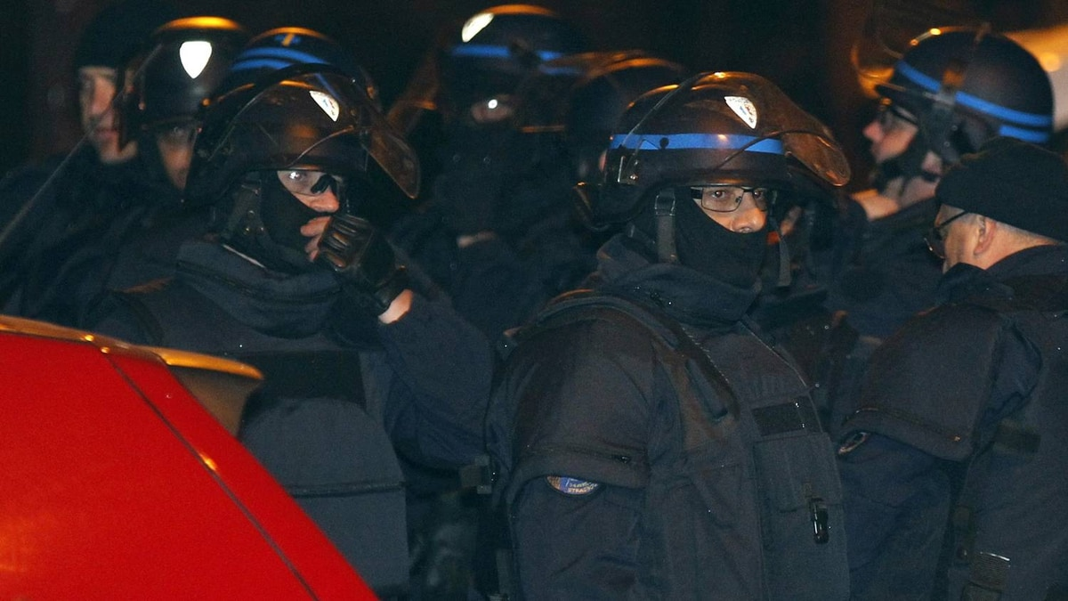 French CRS riot police secure the street near the scene during a raid on a five-storey building to arrest a suspect in the killings of three children and a rabbi on Monday at a Jewish school, in Toulouse March 22, 2012