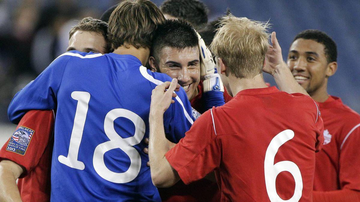 Canada's Lucas Cavallini, center, celebrates with teammates Michal Misiewicz (18) and Kyle Bekker (6) after they defeated the United States 2-0 in a CONCACAF Olympic qualifying soccer match on Saturday, March 24, 2012, in Nashville, Tenn. Cavallini scored a goal in the win. (AP Photo/Mark Humphrey)