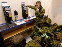 Master Corporal Dan Russel speaks to his wife on the phone at CFB Trenton before leaving on a Disaster Assistance Response Team ( DART) humanitarian mission to earthquake ravaged Haiti on Wednesday.