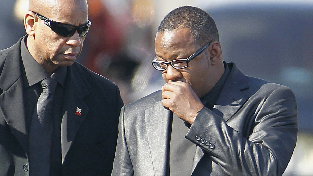 Bobby Brown appeared briefly at the funeral service of his ex-wife, pop singer Whitney Houston, on Saturday.