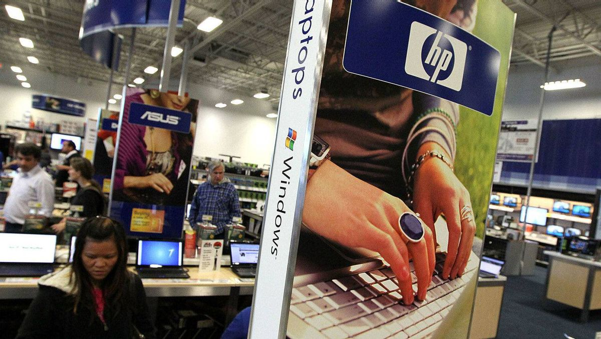 An ad for HP laptops is displayed at a Best Buy store