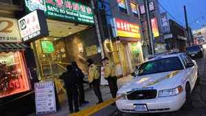 Police investigate a crime scene at a restaurant in Toronto's Chinatown on Dec. 28, 2011.
