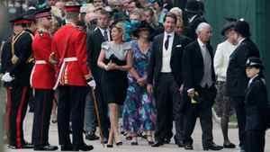 People wait to enter Westminster Abbey prior to the Royal Wedding in London Friday, April, 29, 2011.