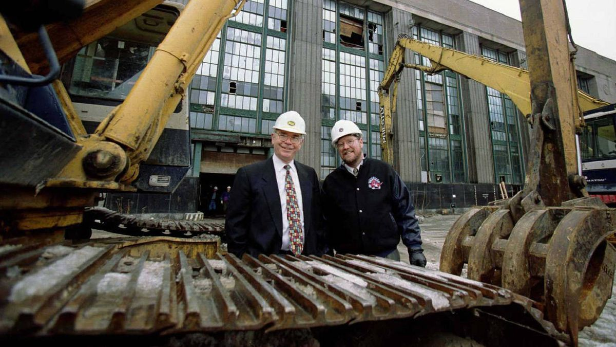 """Bill Senn (R), Executive Director for construction of Air Canada Center, the new home of the Toronto Raptors basketball team, stands with Manager of Construction Ian Stewart (L) at the site of the new arena, February 5, in downtown Toronto. The construction site, a former postal building, went into its first day of operation February 5, with the start of demolition. The arena, nicknamed """"The Hangar,"""" is controversial because the Torornto Maple Leafs of the NHL, plan no association with the facility. Opening is set for the All-Star break in 1999."""