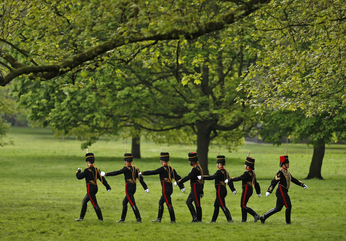 Members of the British military's King's Troop Royal Horse Artillery march away after firing a 41 gun salute in Green Park, to mark the arrival of Britain's Queen Elizabeth II at the Houses of Parliament to deliver her speech at the State Opening of Parliament in London.
