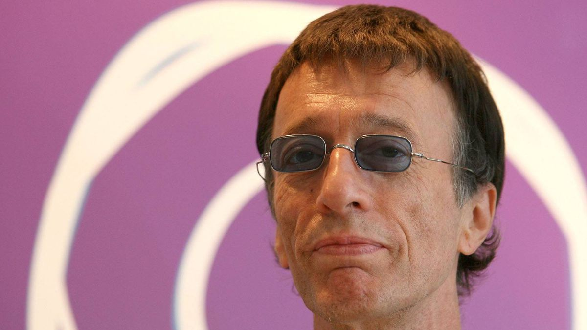 Robin Gibb, founder of the Bee Gees, has woken from a coma more than a week after he lost consciousness.
